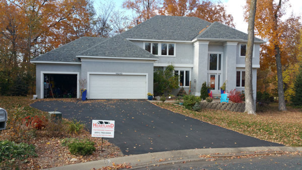 Iowa home with a new roof from Heartland Roofing, Siding and Windows