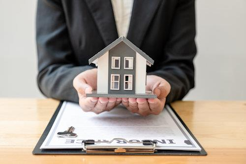 insurance agent holding house